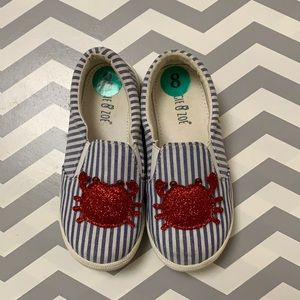 Blue and white striped canvas shoe.